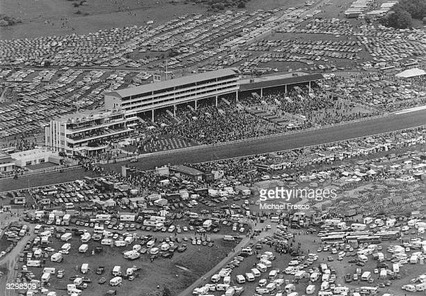 Full car parks surrounding the large crowds gathered to watch the 200th Derby at Epsom racecourse.