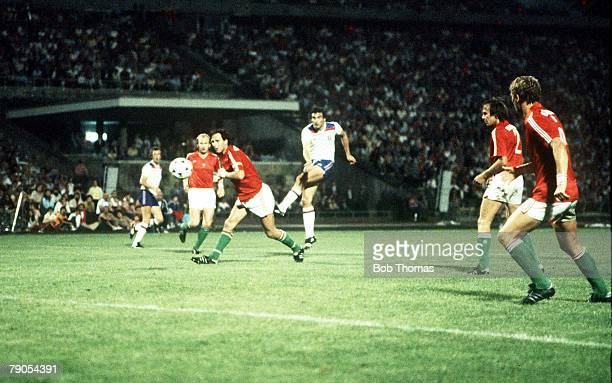 6th JUNE 1981 1982 World Cup Qualifier Hungary Hungary 1 v England 3 England's Trevor Brooking drives in his team's second goal past Hungarian...