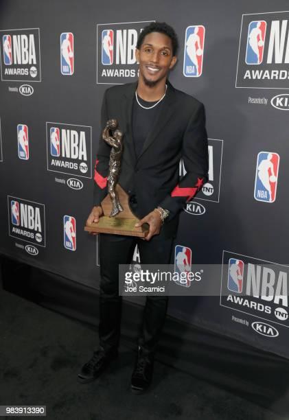 6th Man Award winner Lou Williams poses with his award at the 2018 NBA Awards at Barkar Hangar on June 25 2018 in Santa Monica California