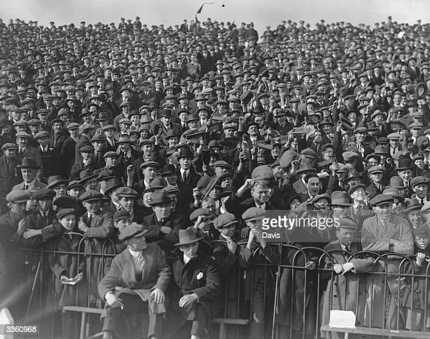 A part of the crowd watching Manchester United play Fulham at Fulham's ground Craven Cottage in London The game was in the sixth round of the FA Cup