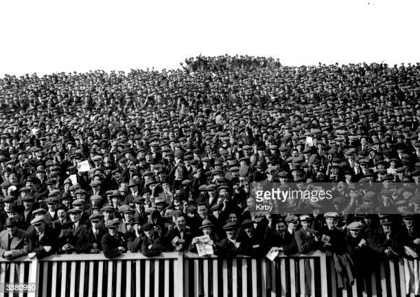 Part of the crowd of supporters at the 6th round FA Cup match at Homerton east London between Clapton Orient and Manchester City