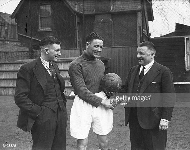 Gerald Matier from Coleraine Ireland on a months trial at Arsenal FC being greeted by George F Allison and Frank Moss