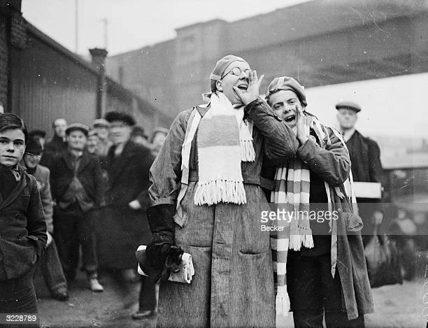 Millwall supporters chanting outside the ground before their team's cup-tie match against Manchester City.