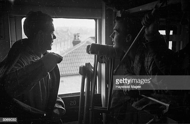 Veterans of the battle of El Alamein J MacCann and H Hutchison looking out of the window of the hospital train taking them back to England Original...