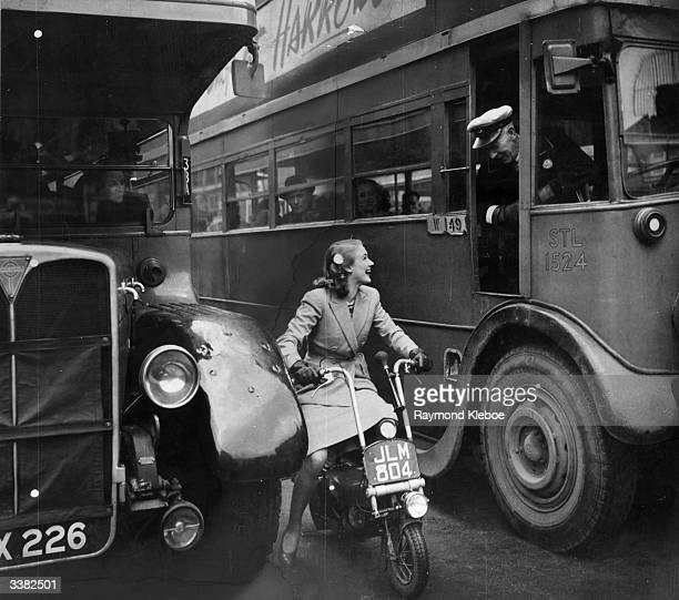 A new film star sets out on a new kind of motorbike which may give London a new way of easing traffic jams Susan Shaw star of the film 'London...