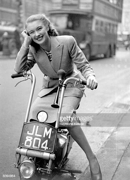 English film actress Susan Shaw riding her scooter Original Publication Picture Post 4518 The Way Ahead pub 1948