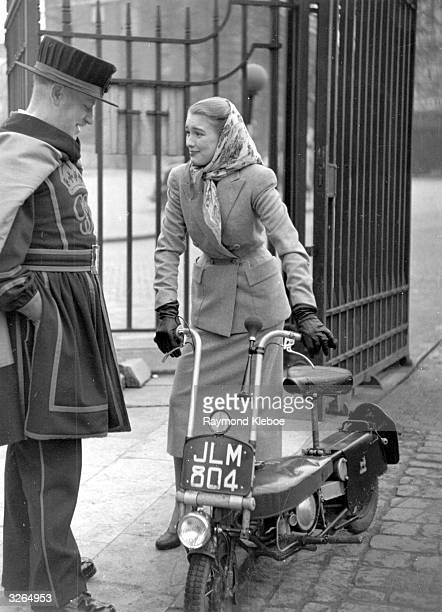 English film actress Susan Shaw talking to one of the beefeaters at the Tower of London Original Publication Picture Post 4518 The Way Ahead pub 1948