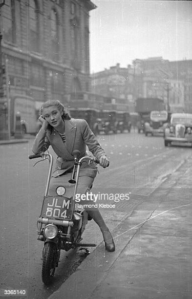 Rank starlet Susan Shaw on a Corgi scooter It has a 98cc twostroke engine weighs 95 lbs does 120mpg and 30 mph Original Publication Picture Post 4518...