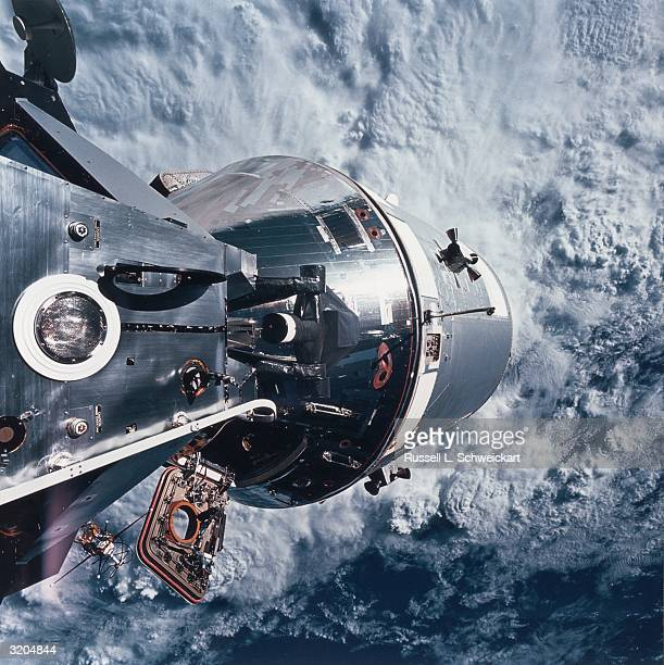 Docked Apollo 9 command service module beyond and the lunar module spider on the left with Earth in the background A preparatory mission for the moon...
