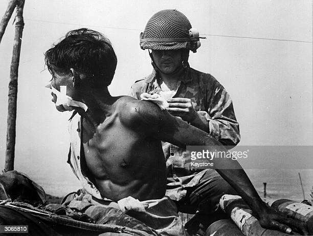 French doctor treating a Vietnamese soldier at Dien Bien Phu.