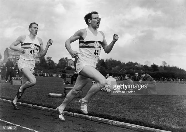 Chris Brasher takes the lead closely followed by Roger Bannister during a historic race at Iffley Road Oxford This was the event which saw Bannister...