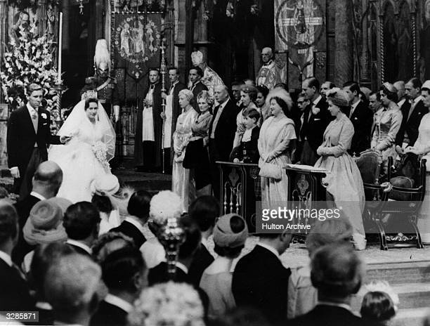Princess Margaret and Antony Armstrong-Jones starting to leave the church, passing through the other members of the Royal family, after their wedding...