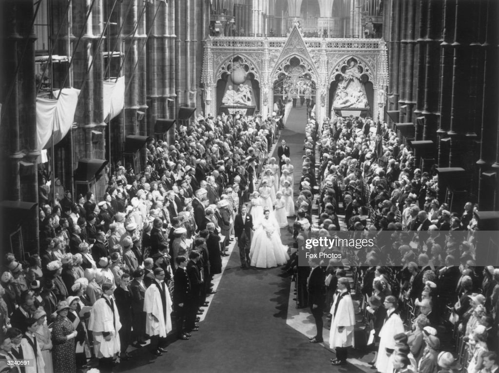Princess Margaret (1930 - 2002) and her husband Antony Armstrong-Jones walking down the aisle at Westminster Abbey after their marriage ceremony.