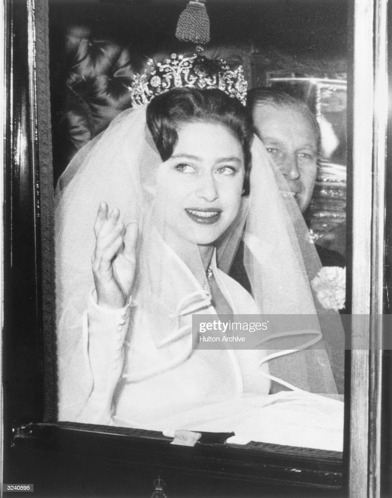 Princess Margaret (1930 - 2002) on her way to Westminster Abbey to marry Antony Armstrong-Jones. She is with Prince Philip, Duke of Edinburgh who is giving her away.