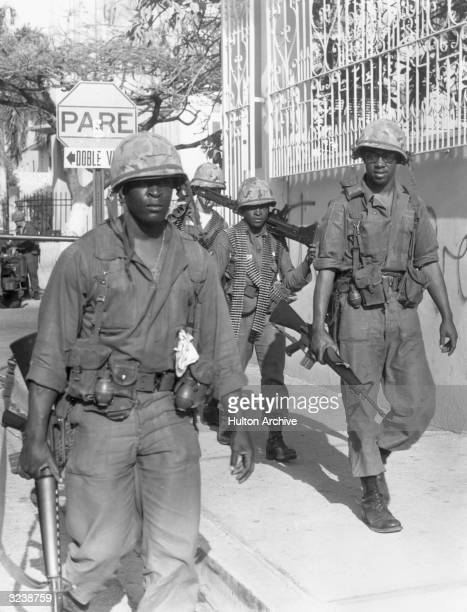 US Army troops patrol the streets of Santa Domingo Dominican Republic on guard against sniper fire and traffic in rebel arms during the Dominican...