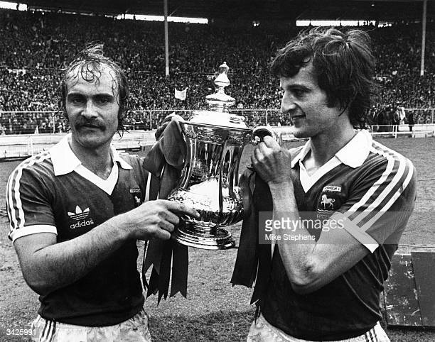 Ipswich Town captain, Mick Mills holding the FA Cup with Roger Osbourne, the scorer of the only goal in an FA Cup final that saw Ipswich beat Arsenal...