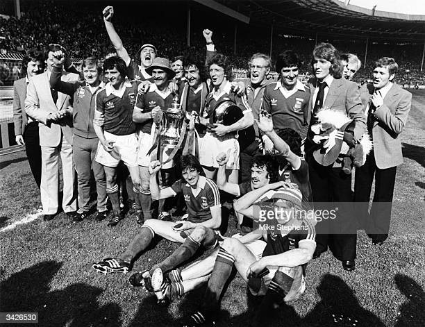 The Ipswich Town squad celebrating after beating Arsenal 10 in the FA Cup final at Wembley Stadium including the manager Bobby Robson Allan Hunter...