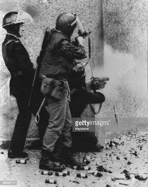 British troops open fire with plastic bullets at Republican demonstrators in Belfast after news of the death of IRA hunger striker and MP Bobby Sands