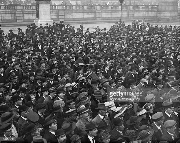 Men and women attend at suffragette meeting in Trafalgar Square London where Emmeline Pankhurst is speaking