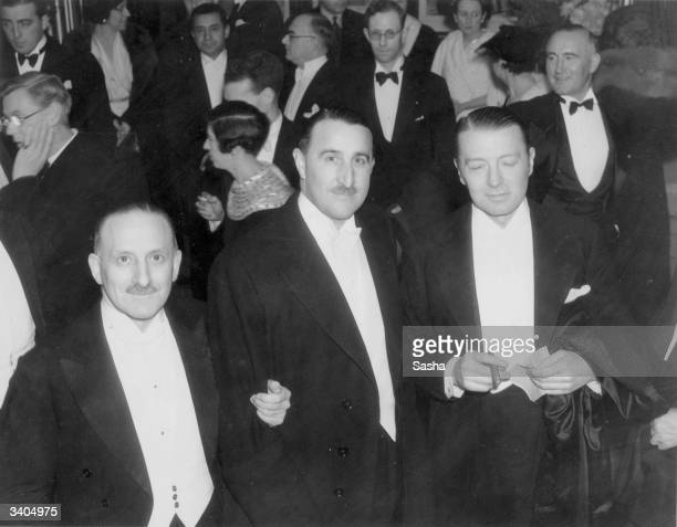 Mr C M Woolf, Mr J Arthur Rank and Mr Clive Brook at the premiere of 'Moscow Nights' at Leicester Square Theatre, London.