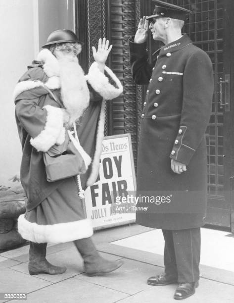 Even Father Christmas follows the war time safety precautions as he arrives this year, complete with tin helmet, at London's famous Brompton road...