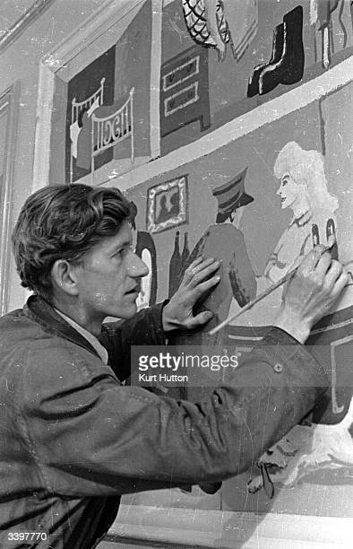 Artist George Haslam works on a mural to decorate a restaurant in Hammersmith London Original Publication Picture Post 1571 Artists Decorate A...