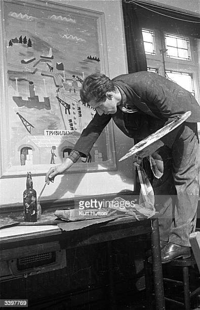 Artist Julian Trevelyan works on a mural to decorate a restaurant in Hammersmith London Original Publication Picture Post 1571 Artists Decorate A...