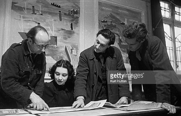 Artists George Downs Rose Ellanby Heine Henrion and Julian Trevelyan work together on a mural to decorate a restaurant in Hammersmith London Original...