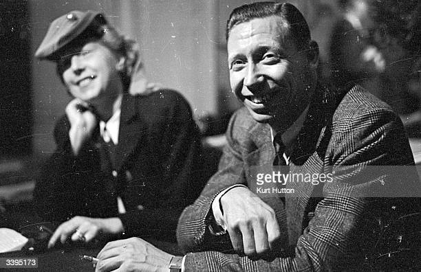 The English entertainer George Formby with his wife Beryl at a press conference at the Waldorf Hotel London where Formby attacked entertainers that...