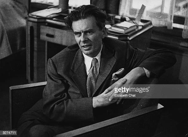 Novelist and essayist Aldous Leonard Huxley being interviewed in London after a 12 year absence from England Original Publication Picture Post 4662...