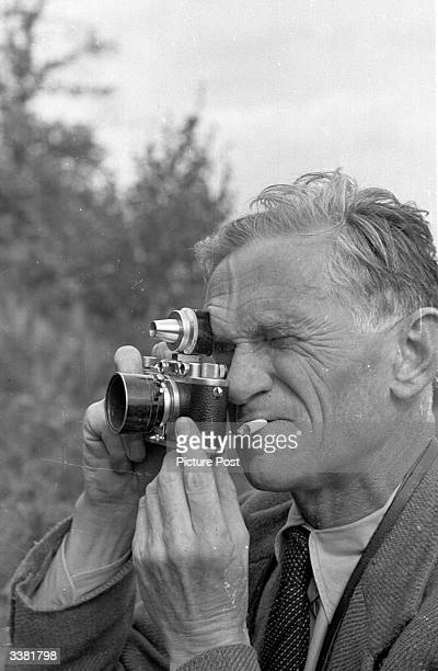 Picture Post photographer Kurt Hutton photographing Londoners on a weekend horse riding break near Ashdown Forest in Sussex. Original Publication:...