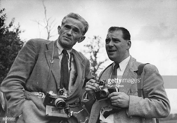 Picture Post photographers, Kurt Hutton, left, and Bert Hardy, on an assignment at a riding school near Ashdown Forest in Sussex. Original...
