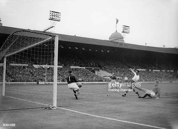 England and Middlesbrough FC striker Brian Clough in action against Sweden.