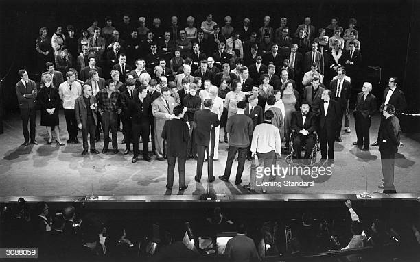Rehearsals for a Royal Variety performance. Present on stage are Harry H Corbett and Wilfrid Brambell , The Beatles, Harry Secombe , Max Bygraves,...