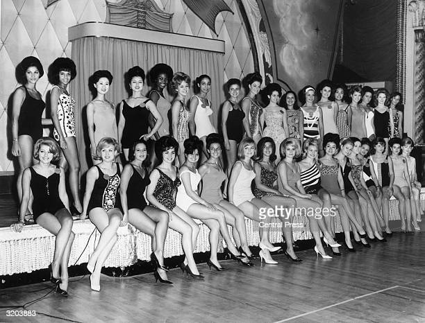 Fifty Miss World contestants from all over the globe pose in their bathing suits at the Lyceum Ballroom in London a few days before the start of the...