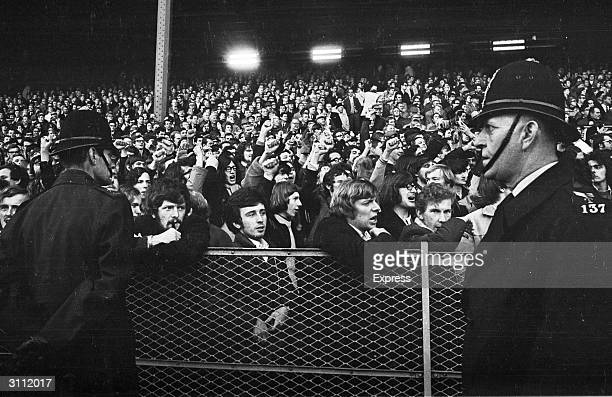Police keeping a watchful eye on the crowd during an Oxford versus South Africa rugby match because of antiapartheid demonstrations