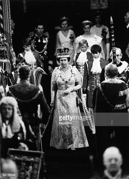 Queen Elizabeth II enters the House of Lords through the Royal Gallery during the State Opening of Parliament