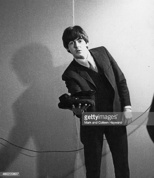 Paul McCartney holds a cap in his hand backstage at the Gaumont Cinema in Southampton England on 6th November 1964