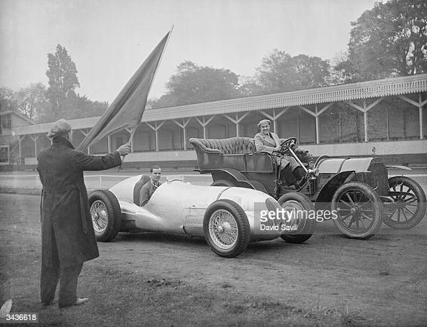 Dick Seaman and Herr Heck at the wheels of their Mercedes' at the start of a race