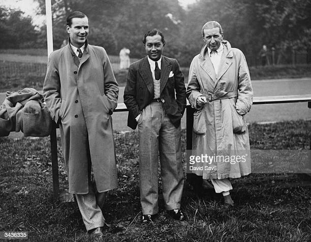 Racing car drivers Dick Seaman Prince Birabongse 'Bira' Bhanudej Bhanubandh of Siam and Count Carlo Felice Trossi before Britain's first...