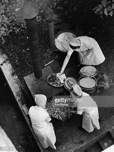 A wartime London County Council field kitchen in use for homeless and when gas and electricity supplies are interrupted