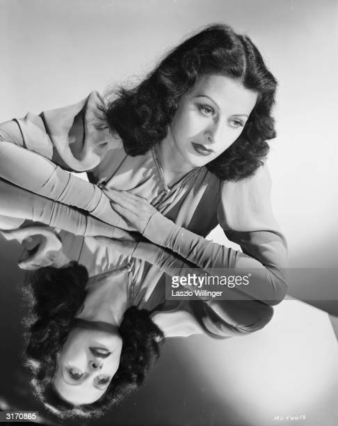 Austrian born actress Hedy Lamarr deep in thought with arms akimbo