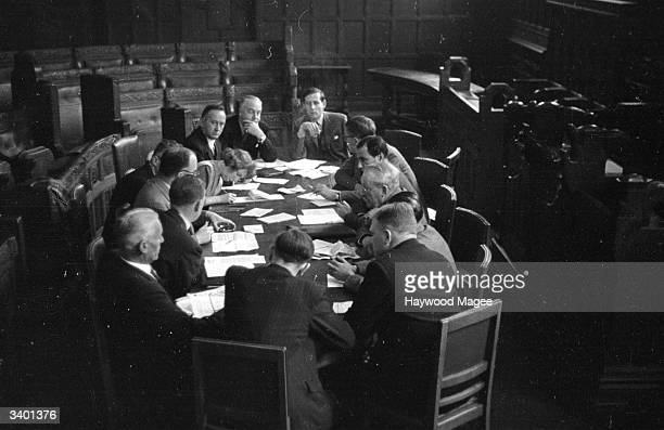 A meeting between unions employers and politicians in Coventry A F Dick of Standard Motors Labour MP Richard Crossman Labour MP Maurice Edelman...