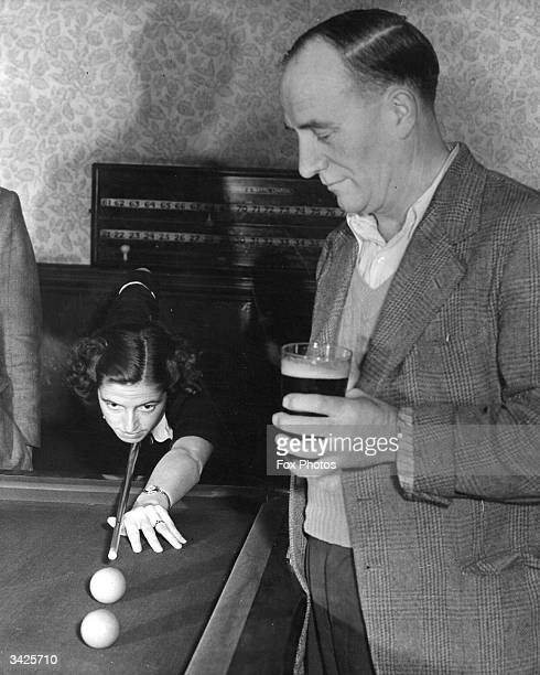 Kathleen Scott aged 20 of Bethnal Green east London an entrant for the Women's Amateur Snooker Championships who is not allowed to practise in any of...