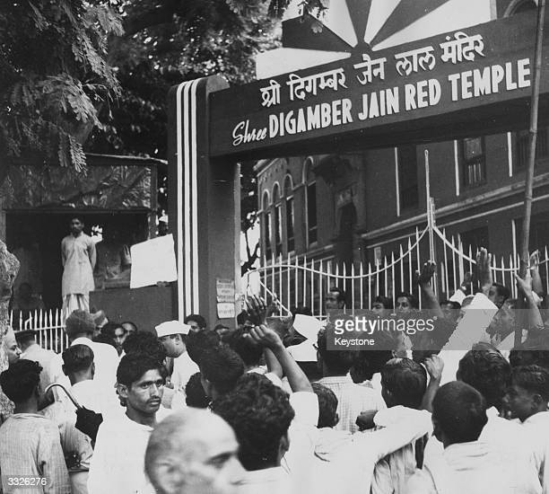 A crowd of Harijans demonstrating at the gates of Digamber Jain Red Temple at Delhi after they were refused entry on the 86th anniversay of the birth...