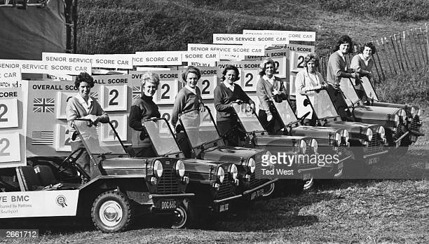 Eight female amateur golfers at the wheel of their mini mokes at Royal Birkdale in Southport They will drive around the golf course during the...