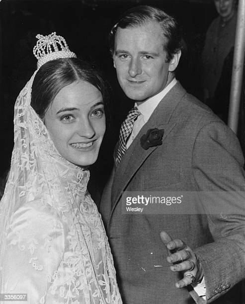 Desmond Fitzgerald the 29th Knight of Glin alongside his new French wife Louise de la Falaise after their wedding in London
