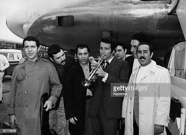 Herb Alpert and the Tijuana Brass at London Airport in London to play at the Royal Albert Hall in 1966 Herb Alpert holding the trumpet to his lips