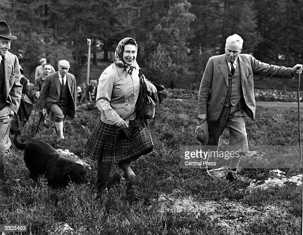 Queen Elizabeth II with her dog 'Wren' at the Open Stake Retriever Trials at Balmoral.