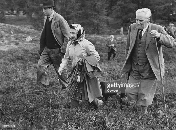 Queen of Great Britain Elizabeth II attends the North of Scotland Gun Dog Association's Open Stake Retriever Trials at Balmoral with one of the Trial...